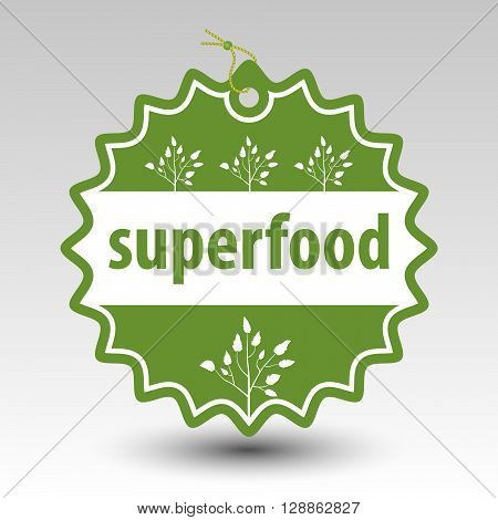 vector green superfood round stamp tag label with string and bead and with white silhouette of plant