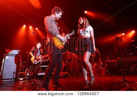 NEW YORK-FEB 25: Singer Cassadee Pope (R) performs onstage at the PlayStation Theater on February 25, 2016 in New York City.