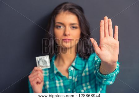 Attractive Young Woman With Condom