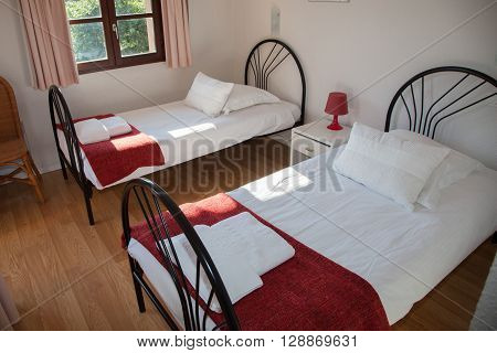 Two Single Beds In Cozy Bedroom In A Bright House