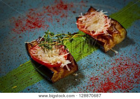 Baked aubergines with tomato and tomatoe and cheese