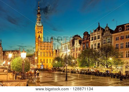 GDANSK, POLAND - MAY 05, 2016: Street scene with some people on Long Street at night in Gdansk. Old Town in Gdansk is a tourist attraction for visitors.