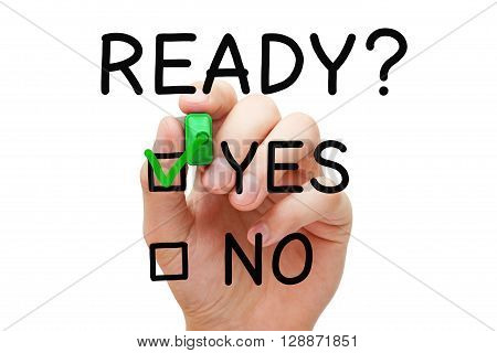 Hand putting check mark with green marker on Yes Ready. Readiness concept.