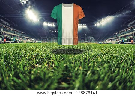 Ireland national flag on t-shirt on football stadium, greem grass