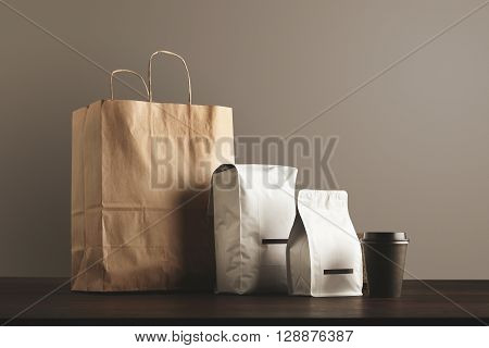 Presentation Of Retailer Package Set: Craft Paper Bag, Big Pouch, Small Container And Take Away Glas