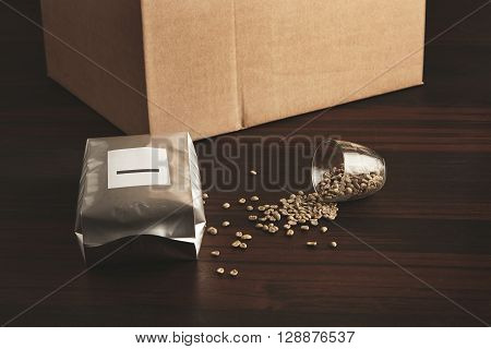 Hermetic Silver  Package Filled With Freshly Baked Roasted Coffee To Preserve Its Aroma On Red Woode