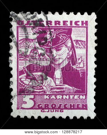ZAGREB, CROATIA - SEPTEMBER 13: a stamp printed in the Austria shows Woman from Carinthia, Regional Costume, circa 1934, on September 13, 2014, Zagreb, Croatia