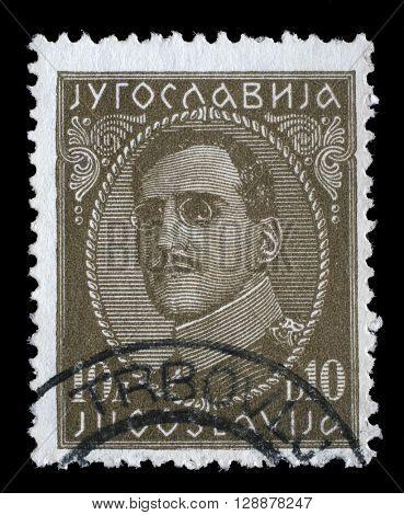 ZAGREB, CROATIA - SEPTEMBER 18: Stamp printed in Yugoslavia shows portrait king Alexander I (1888-1934), from series King Alexander I, circa 1932, on September 18, 2014, Zagreb, Croatia