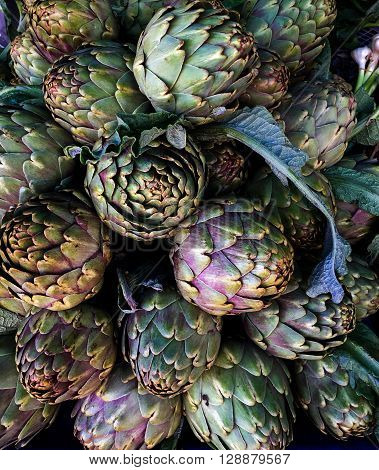 Artichokes on farmers market in the south of Mediterranean, top view