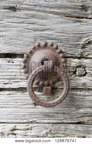 Old door knockers on an old door in Tuscany italy