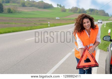 Pretty Young Woman Holding A Traffic Warning Sign