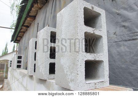 many neatly folded gray cinder blocks background closeup.