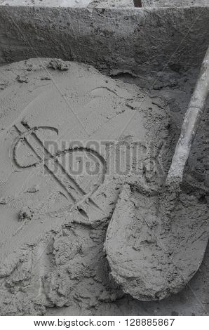 Inscription the dollar on cement with trowel