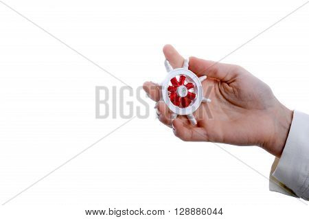 Isolated Ship steering wheel in hand on white background