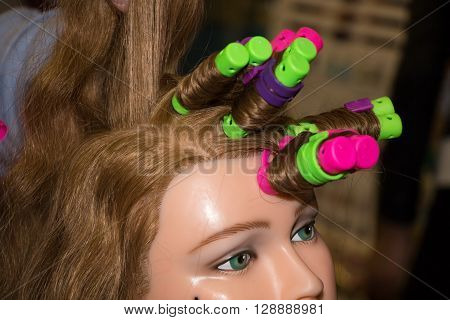 color soft curlers on a woman mannequin head