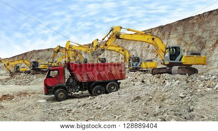 Truck being loaded with crushed stone in the quarry