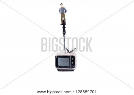 Man standing on the top of a retro styled television set on a white background