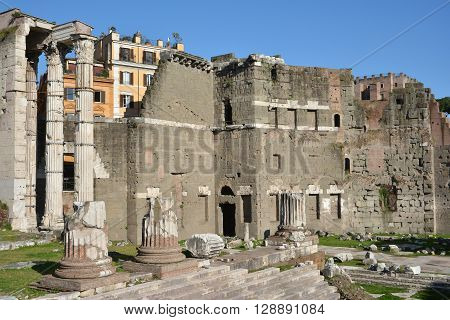 Ruins of Temple of Mars Ultor in Forum of Augustus with protecting wall made by peperino stone blocks in opus quadratum style