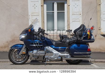 La Petite-Pierre, Alsace, France - May 7, 2016: Blue Honda Goldwing parked on the side of the street in the city of La Petite-Pierre.