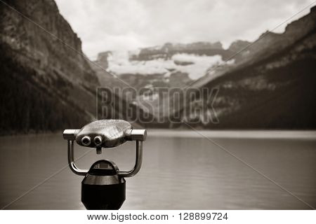 Lake Louise with binocular in Banff national park with mountains and forest in Canada.