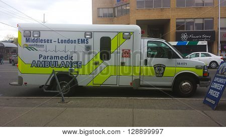 London Ontario Canada - May 03 2016: ambulance waiting on the Ontario street during the day as editorial