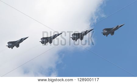 Moscow - May 7 2016 four MiG-31 - double supersonic all-weather fighter-interceptor long-range flying in the sky over Red Square on May 7 2016 Moscow Russia