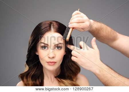 A beautiful woman in the hairdresser .