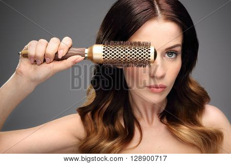 Round brush for styling hair. Beautiful healthy hair.