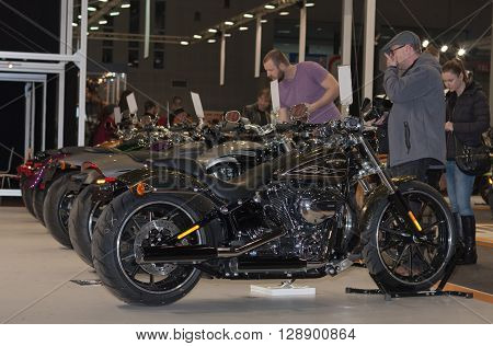 BRNO,  CZECH REPUBLIC-MARCH 4, 2016: Visitors viewing a group of motorcycles Harley Davidson at International Fair for Motorcycles on March 4, 2016 in Brno in Czech Republic.