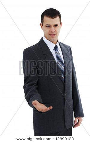 Successful young businessman with open hand - isolated over a white background