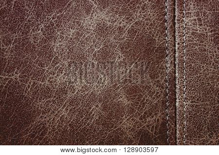Texture brown leather with seam closeup background