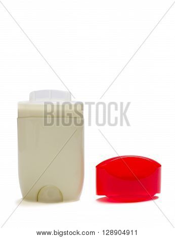 Deodorant with shadow and red cap isolated on white background.