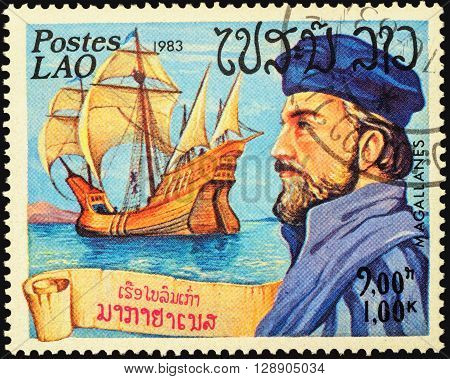 MOSCOW RUSSIA - MAY 06 2016: A stamp printed in Laos shows Ferdinand Magellan and his ship
