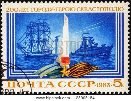 MOSCOW RUSSIA - MAY 06 2016: A stamp printed in USSR (Russia) shows old and modern warships devoted to the 200th Anniversary of Sevastopol circa 1983