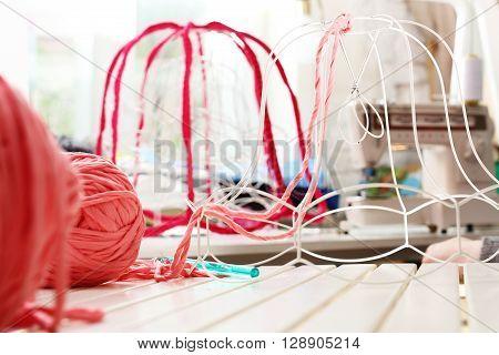 Knitting crochet. The woman knits crochet .