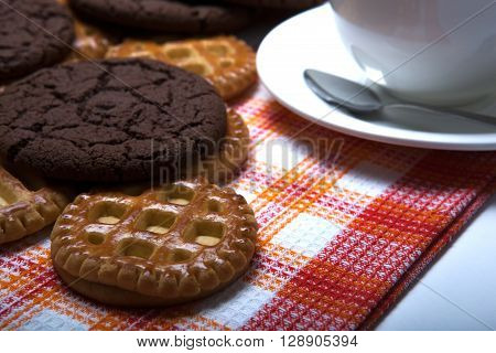 flat biscuits and drinking tea close up