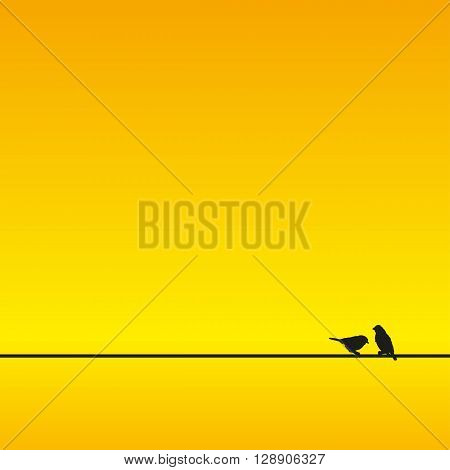 a silhouette of two sparrows sitting on a line