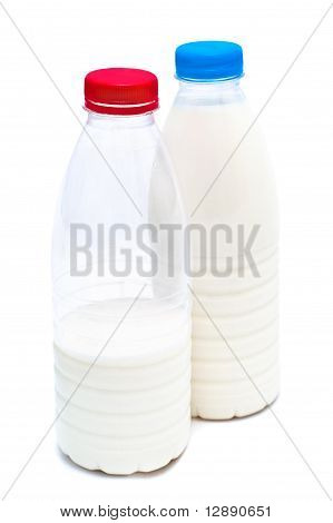 Two White Plastic Bottles With Milk