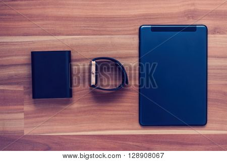 Powerbank, Smart Watch And Tablet Pc On The Floor