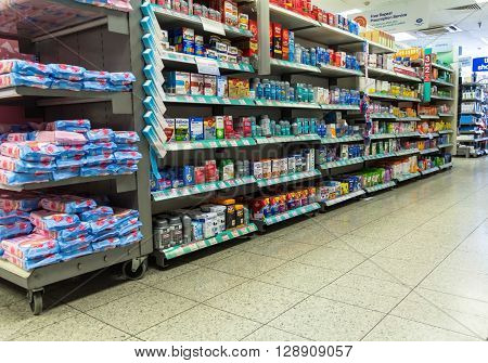 LONDON UK - JUNE 7 2015:Long shelves filled with goods offered for purchase  small store on Baker street.