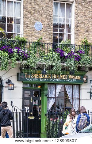 LONDON UK - JUNE 6 2015: Facade of the Sherlock Holmes house and museum in 221b Baker Street. Here is where Arthur Conan Doyle located the studio of the famous detective.