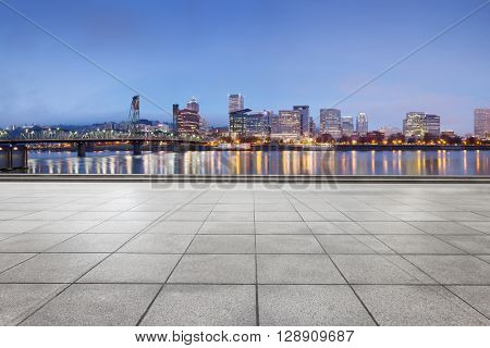 empty marble floor with cityscape and skyline of portland