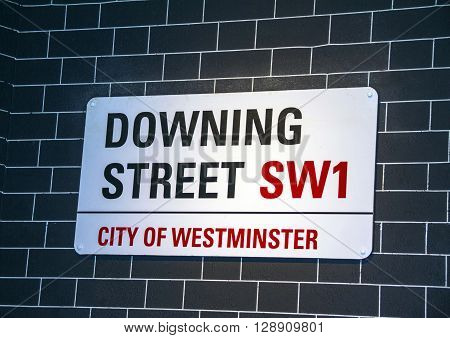 LONDON UK - JUNE 7 2015: Downing Street's sign in Westminster. Downing St. has housed government leaders for over three hundred years.