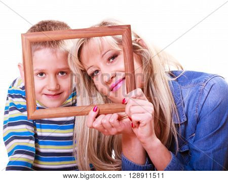 Spending time family bonds parenthood. Mother and son have fun play with empty picture frame hold in hand.