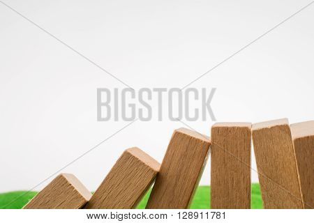 Brown color Wooden dominos on green grass