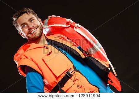 Lifeguard man in life vest jacket with ring buoy lifebuoy supervising.