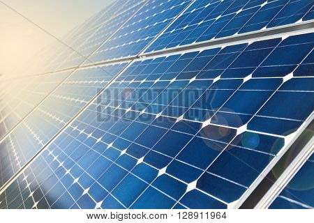 Closeup of photovoltaic solar cell and sunlight