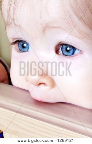 Baby Biting On Crib - Closeup
