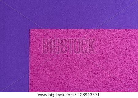 Eva foam ethylene vinyl acetate sponge plush pink surface on purple smooth background
