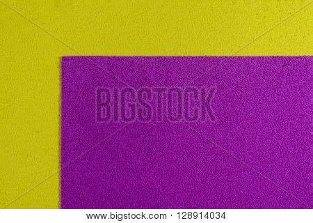 Eva foam ethylene vinyl acetate pink surface on lemon yellow sponge plush background